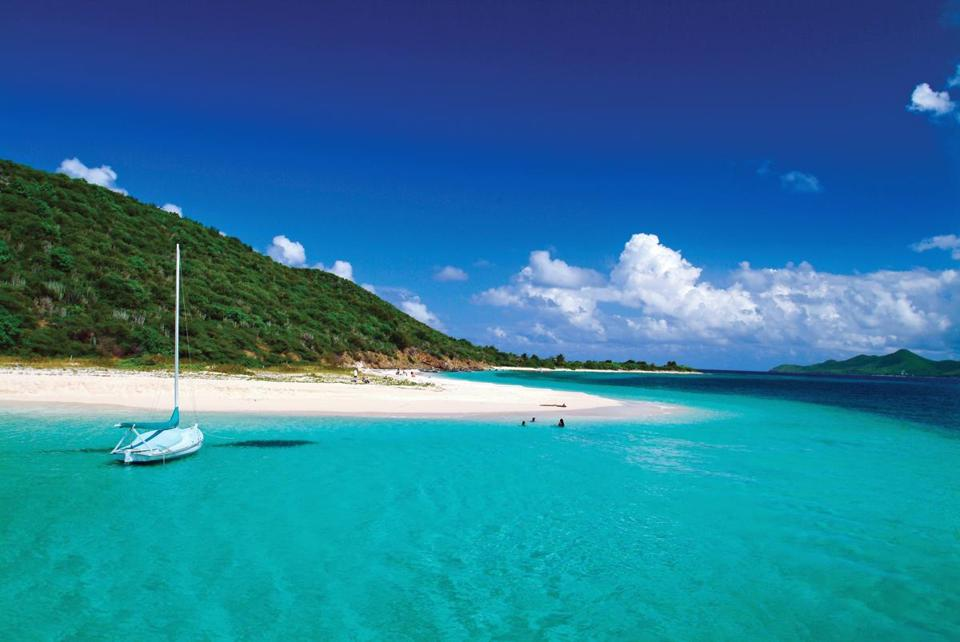 Warm temperatures and white-sand beaches at Buck Island, St. Croix, entice the winter-weary.