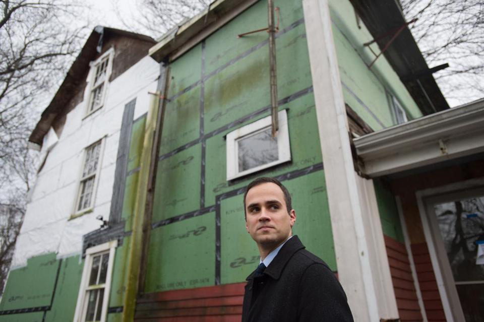 Assistant Attorney General Jason Piques (shown at a derelict property) helped the Town of Franklin clean up several run-down homes.