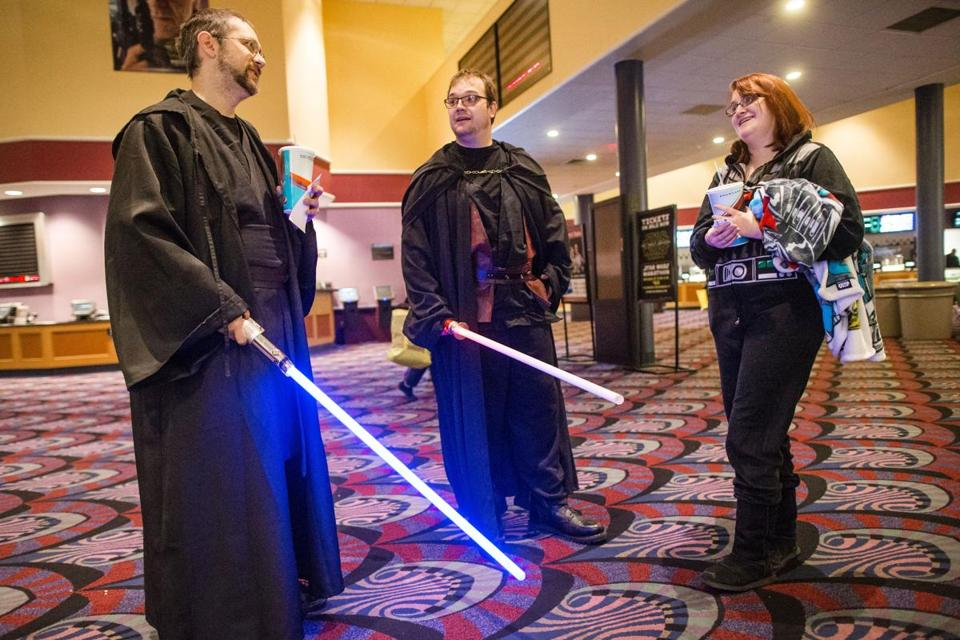 "Ben Brown (left), Nate Piercey (center), and Dani Mansur waited in the lobby before the start of the 18-hour ""Star Wars"" film marathon at the Showcase Cinema de Lux in Revere."
