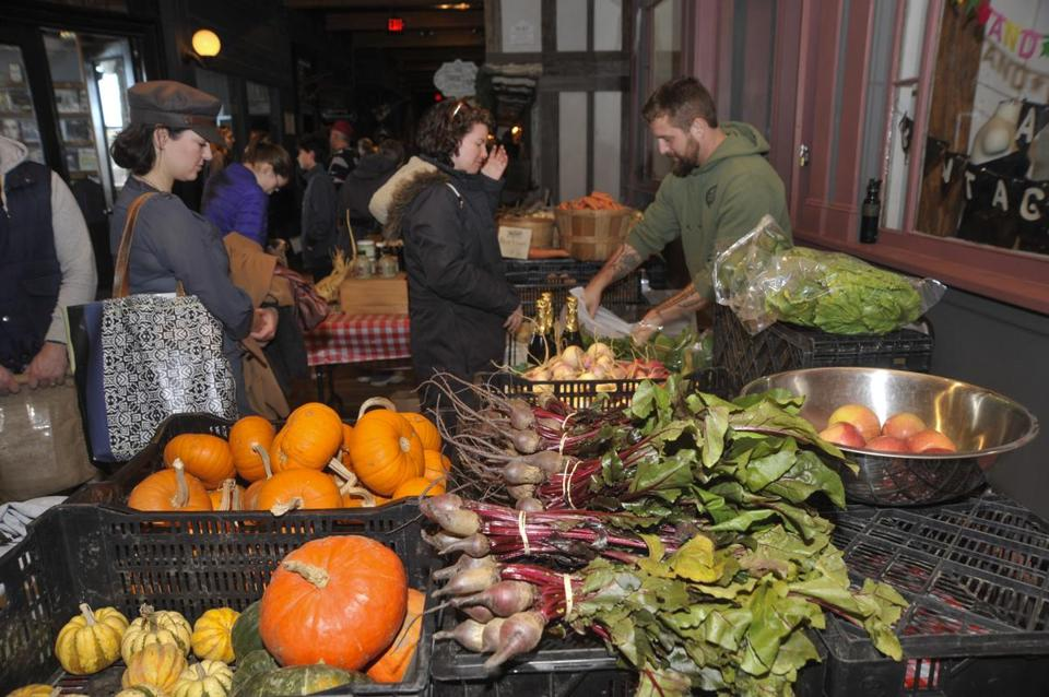Customers lined up last fall to buy fresh produce at the Mill City Grows farmers market booth in Lowell.