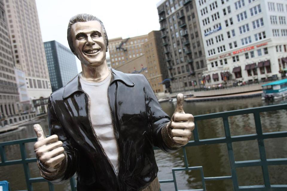 The Bronze Fonz on the Milwaukee Riverwalk just south of Wells Street in downtown Milwaukee.