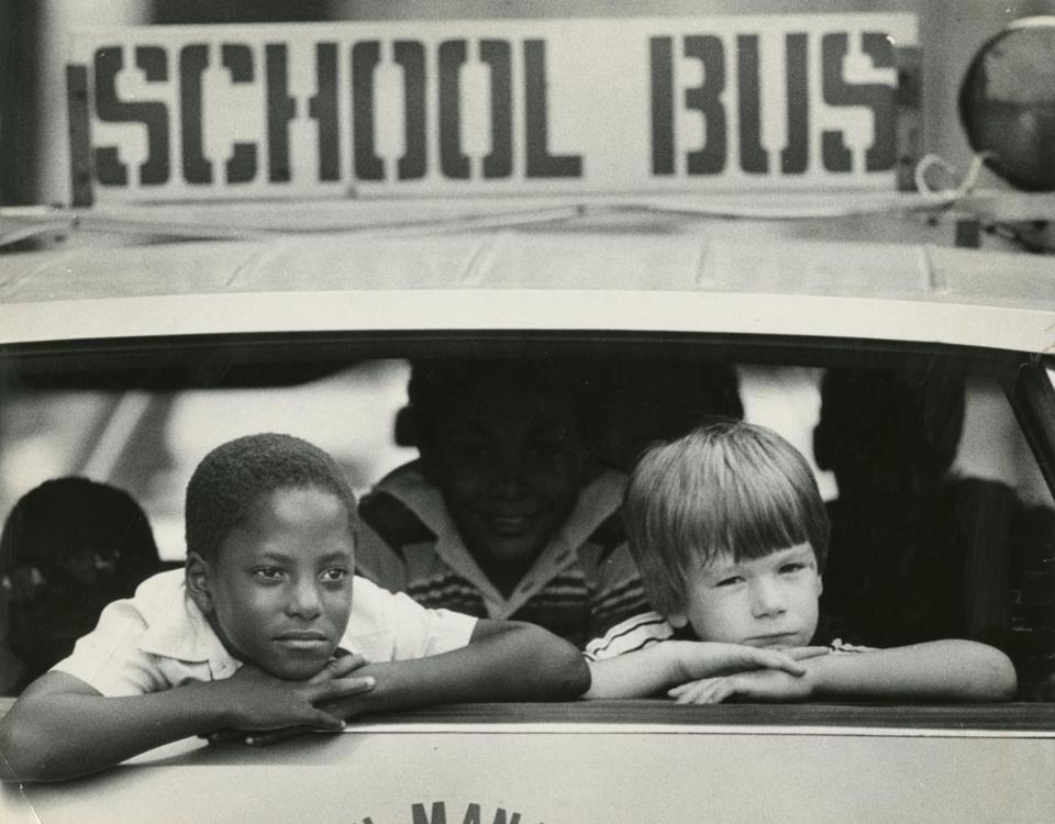 David Patterson, 8, and Chris Russell, 7, rode home from the first day at McKay School in East Boston in September 1979.