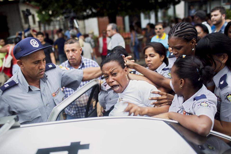 Cuban security personnel detained a member of the Ladies in White dissident group during a protest on International Human Rights Day in Havana, Dec. 10.