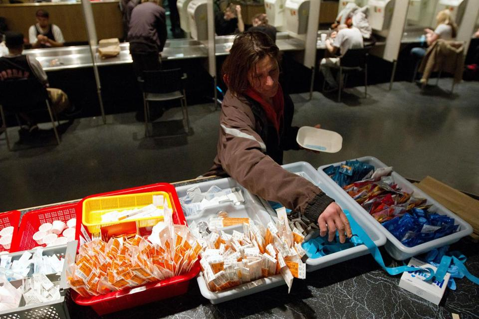 A client of an Insite supervised injection center in Vancouver collecting a kit.