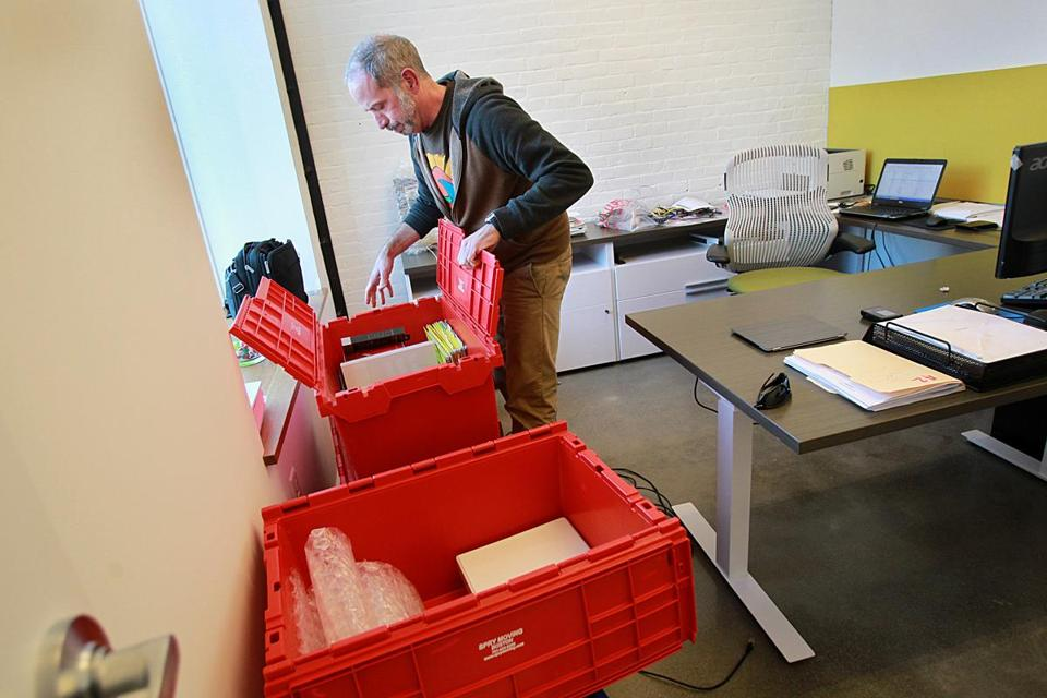 Illuminate founder Shaun McMahon was going through moving bins on the first day in his new office in the South End.