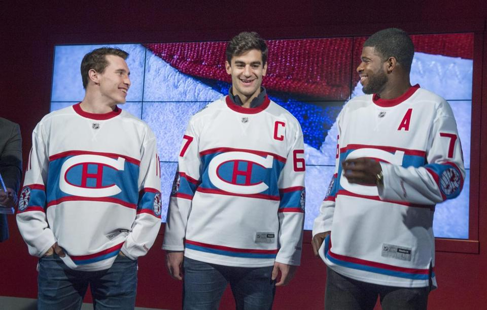 Montreal Canadiens' Brendan Gallagher, Max Pacioretty, and P.K. Subban, left to right, show off the team's jersey to be worn during the 2016 NHL Winter Classic hockey game Friday, Nov. 6, 2015, in Montreal. The Canadiens will face the Boston Bruins at Gillette Stadium in Foxborough, Mass., on Jan. 1, 2016. (Paul Chiasson/The Canadian Press via AP)
