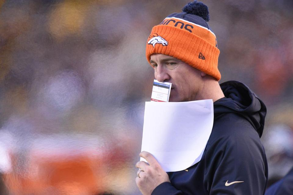 Denver Broncos quarterback Peyton Manning (18) on the sideline in the first  half of c451a8680950