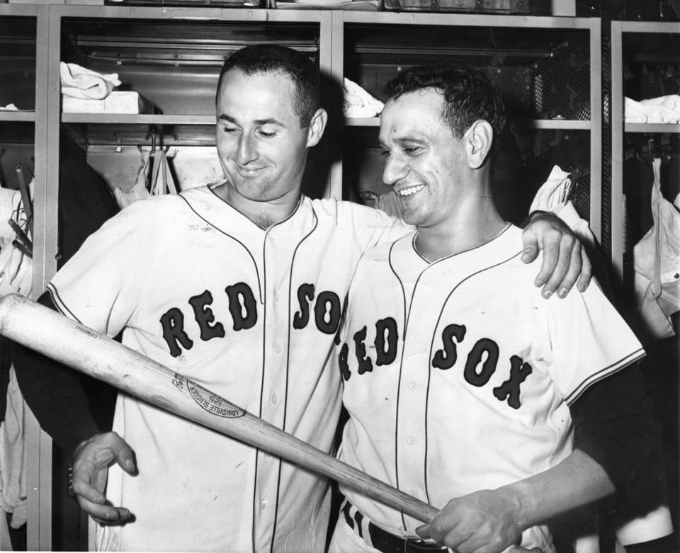 Red Sox pitcher Bill Monbouquette and Frank Malzone examined a bat that Malzone used for his fourth home run of the season in the ninth inning of a 1962 game with the Detroit Tigers at Fenway Park.
