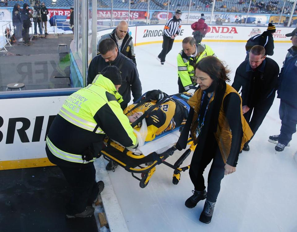 FOXBORO, MA - DECEMBER 31: Denna Laing #24 of the Boston Pride (NWHL) is taken off the ice following an injury against the Les Canadiennes (CWHL) during the Outdoor Womens Classic at Gillette Stadium on December 31, 2015 in Foxboro, Massachusetts. (Photo by Maddie Meyer/Getty Images)