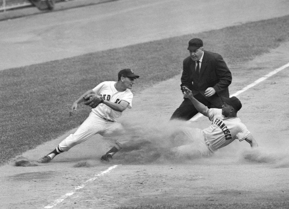 Willie Mays slid into third, just under a tag from Frank Malzone, in the 1960 All-Star Game.