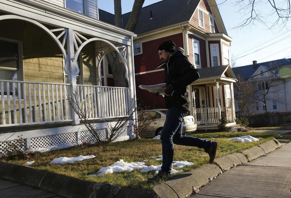 Globe reporter Steve Annear ran to deliver a newspaper in Somerville.