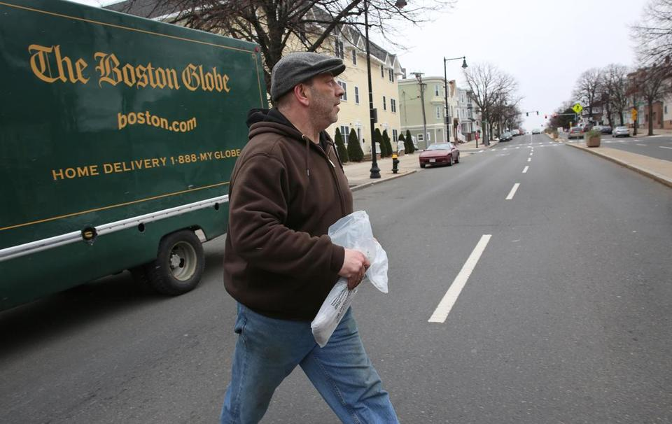 Boston Globe truck driver Eliot Resnick delivered newspapers in East Boston on Monday.