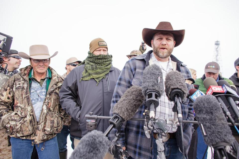 Ammon Bundy(R), leader of a group of armed anti-government protesters speaks to the media as other members look on at the Malheur National Wildlife Refuge near Burns, Oregon January 4, 2016. The FBI on January 4 sought a peaceful end to the occupation by armed anti-government militia members at a US federal wildlife reserve in rural Oregon, as the standoff entered its third day. The loose-knit band of farmers, ranchers and survivalists -- whose action was sparked by the jailing of two ranchers for arson -- said they would not rule out violence if authorities stormed the site, although federal officials said they hope to avoid bloodshed. AFP PHOTO / ROB KERRROB KERR/AFP/Getty Images