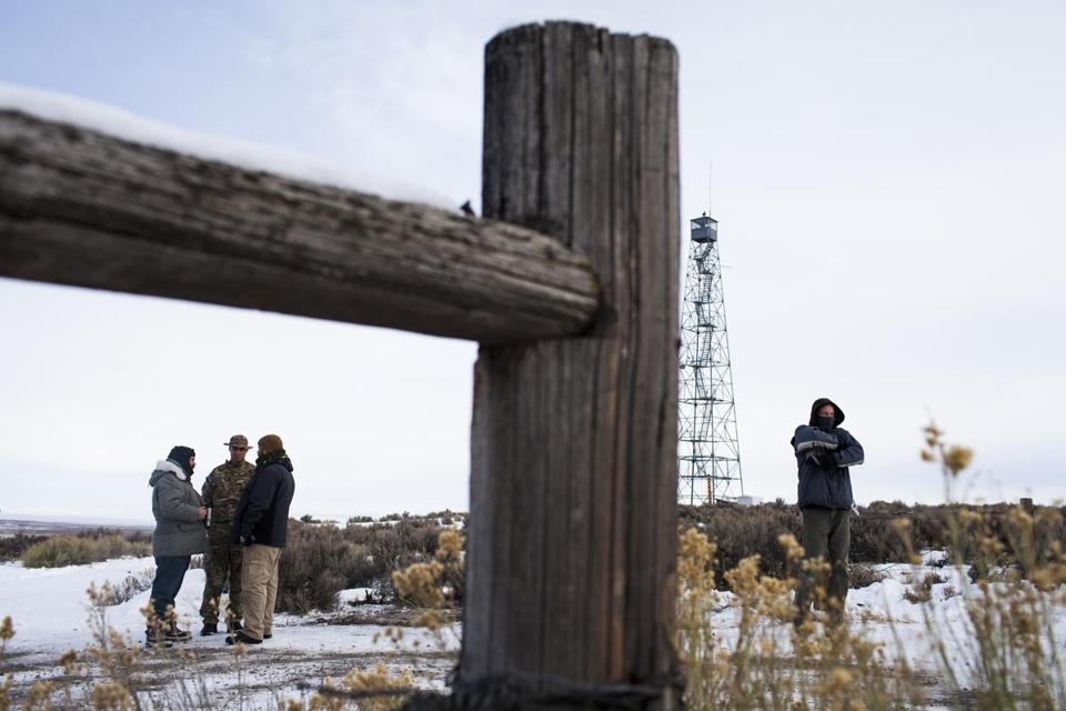 "Men stand guard at an entrance to the Malheur National Wildlife Refuge, Princeton, Ore., Jan. 4, 2016. The small band of antigovernment protesters who took over some federal buildings in rural Oregon say they aim ""to restore and defend the Constitution,"" in particular the rights of ranchers, and set off a national movement, forcing the federal government to release its hold on vast tracts of Western land. (Jarod Opperman/The New York Times)"