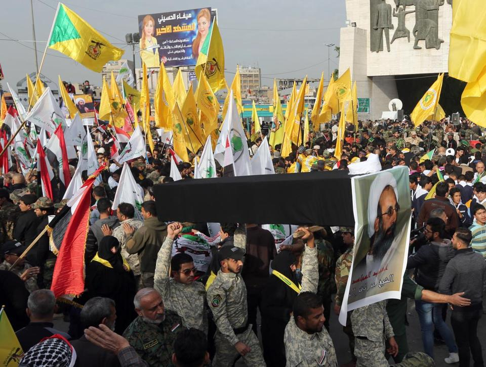 Thousands of Shi'ite militiamen marched in Baghdad on Wednesday to protest Sheikh Nimr al-Nimr's execution.