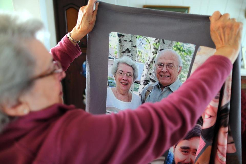 Frances Iacobucci, 85, with a picture of herself and her husband, Michael. Frances could not be at her husband's side at Milford Regional Medical Center when he died.