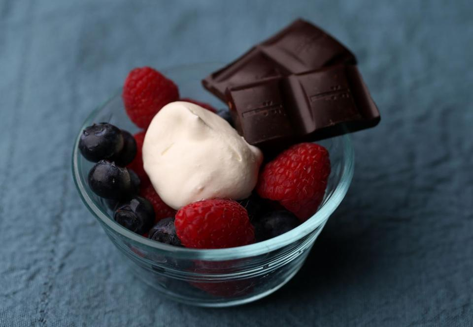 One of the recipes by chef Dawn Ludwig in her husband David's book on eating well is for berries with fresh whipped cream and dark chocolate.