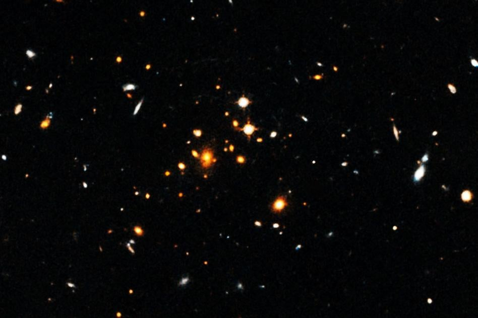 Astronomers have detected a massive, sprawling, churning galaxy cluster that formed only 3.8 billion years after the Big Bang. The cluster, shown here, is the most massive cluster of galaxies yet discovered in the first 4 billion years after the Big Bang.