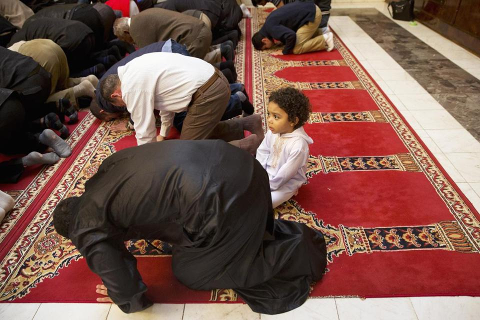 FILE - In this Dec. 4, 2015 file photo, Aiden Abdelaziz, 2, attends prayers with his father, Mohamed Abdelaziz, 22, originally from Cairo, Egypt, at Dar al-Hijrah Mosque in Falls Church, Va. Americans are more likely to say protecting religious liberties of Christians is important than to say the same for Muslims, according to a new poll by The Associated Press and the NORC Center for Public Affairs Research. (AP Photo/Jacquelyn Martin, File)