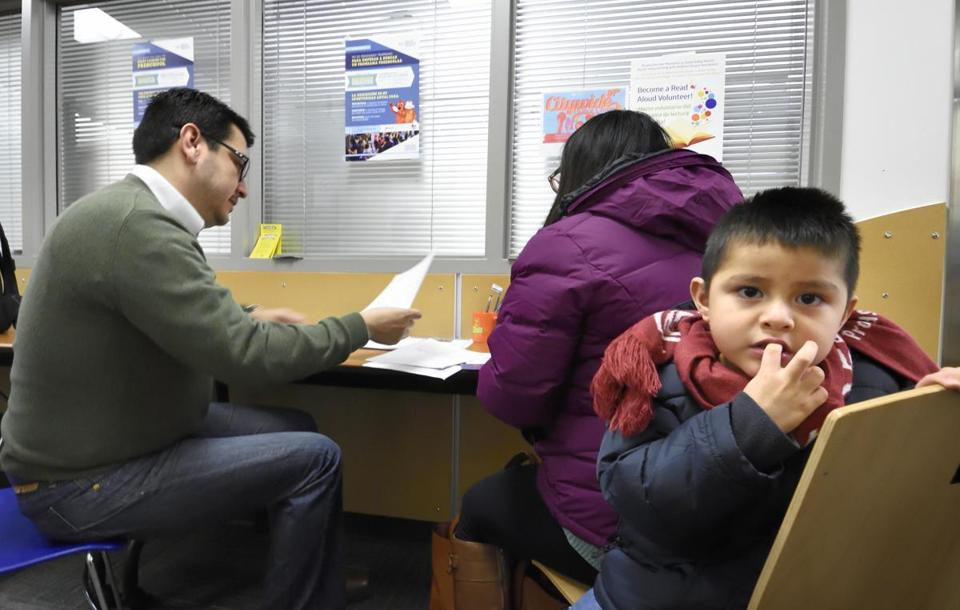 Demaris Villanueva reviewed forms to enroll her son, 3-year-old Israel, in one of Denver's public schools.