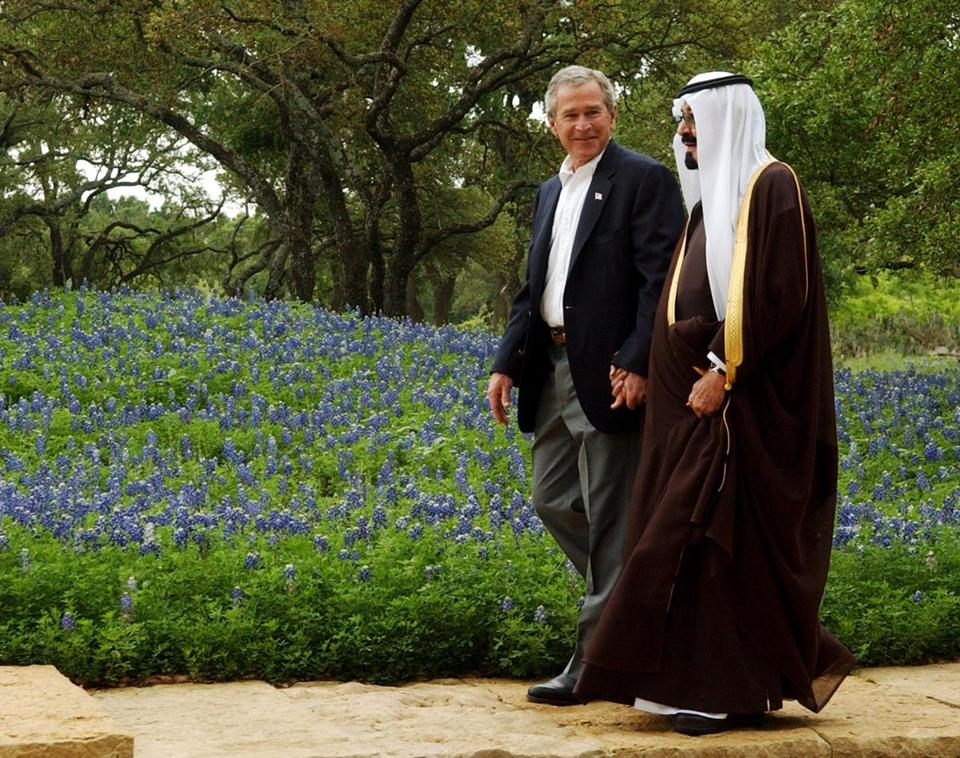 Former President George W. Bush greets Crown Prince Abdullah in Crawford, Texas, on April 25, 2005.