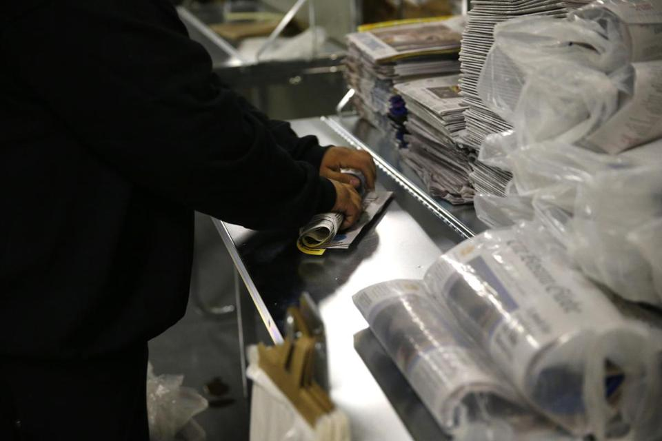 Newspapers were packaged at a Boston Globe delivery distribution center in Medfield earlier this month.