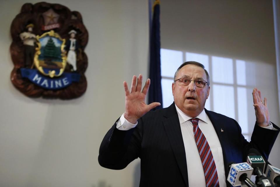 "Gov. Paul LePage speaks at a news conference at the State House in January, where he apologized for his remark about out-of-state drug dealers impregnating ""young white"" girls."