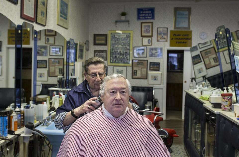 Joe Vaccarella, cuttting David Weselcouch's hair, will miss his customers who work for GE, and their business.