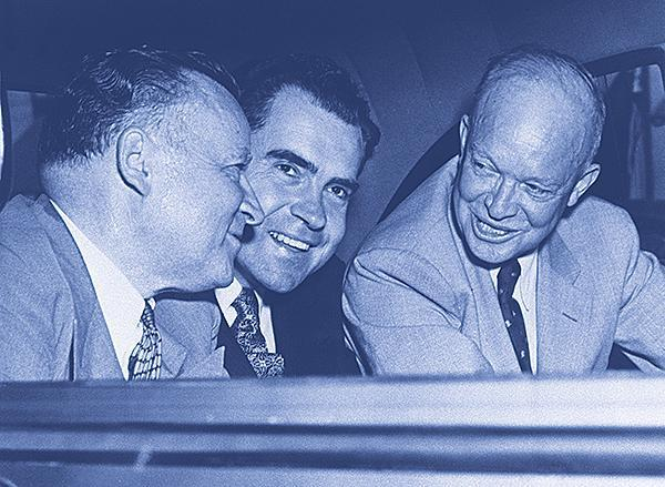 Then US Senator Richard Nixon and Dwight D. Eisenhower speaking at the back of a car in 1952. Other person on picture is unidentified. (Photo credit should read AFP/AFP/Getty Images)