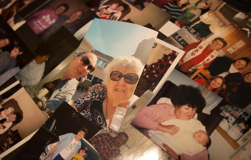 Photos of Mary Meuse and her family on a poster arranged for her funeral. Mary Meuse died after anaccident at her nursing home in December. Photo by Laurie Swope