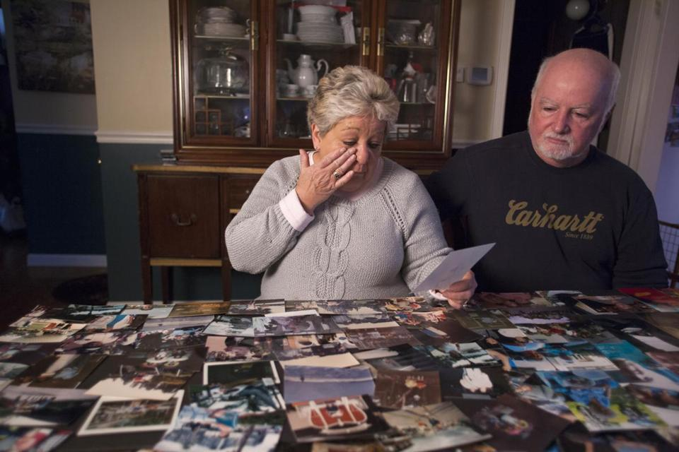 Brenda Murray of Lynn and her husband, Doug, looked over photos of her mother, Mary Meuse, that were displayed at Meuse's funeral.