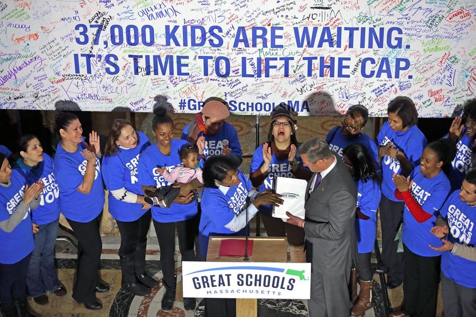 Governor Charlie Baker received a petition with 20,000 signatures advocating expanded charter schools from Dawn Foye, parent of a KIPP school student.
