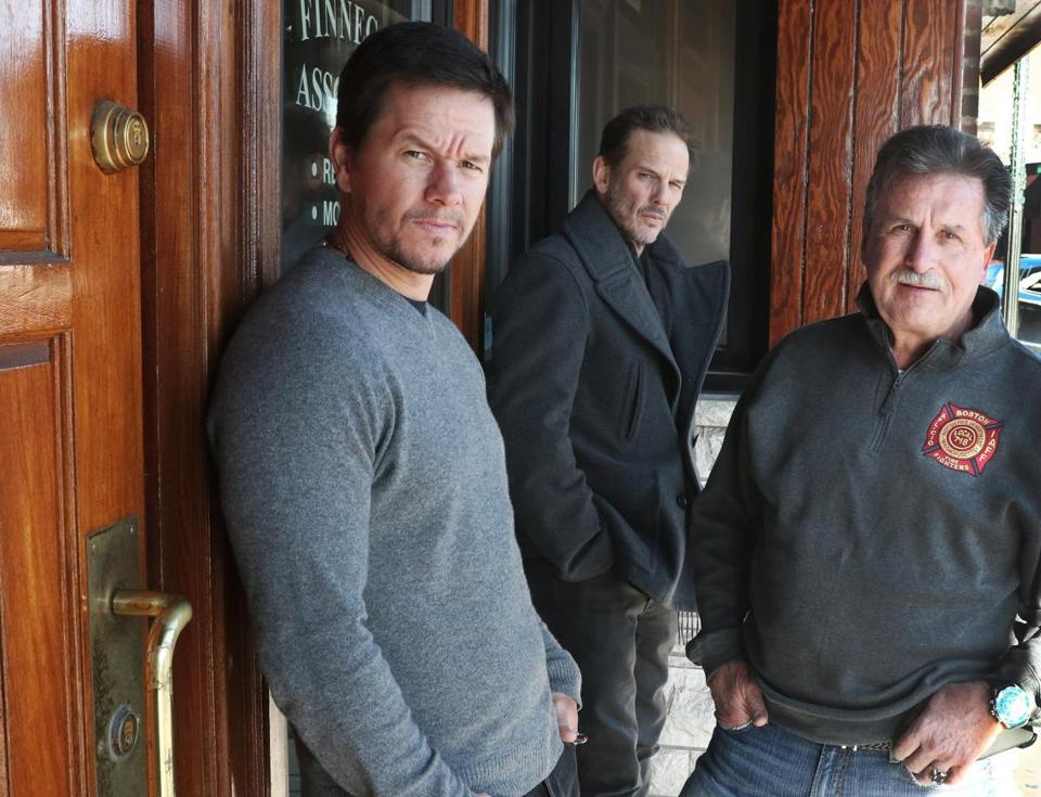 "Actor Mark Wahlberg (left) outside the Eire Pub in Dorchester, where he had lunch with director Peter Berg (center) and Boston Police Detective Danny Keeler, whom Wahlberg will play in the movie ""Patriots Day."""