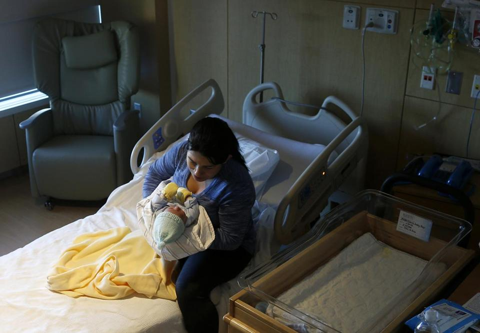 Nelsy Avendano of East Boston cradled her newborn son, Kevin Loaiza-Avendano, in her hospital room at Boston Medical Center last month.