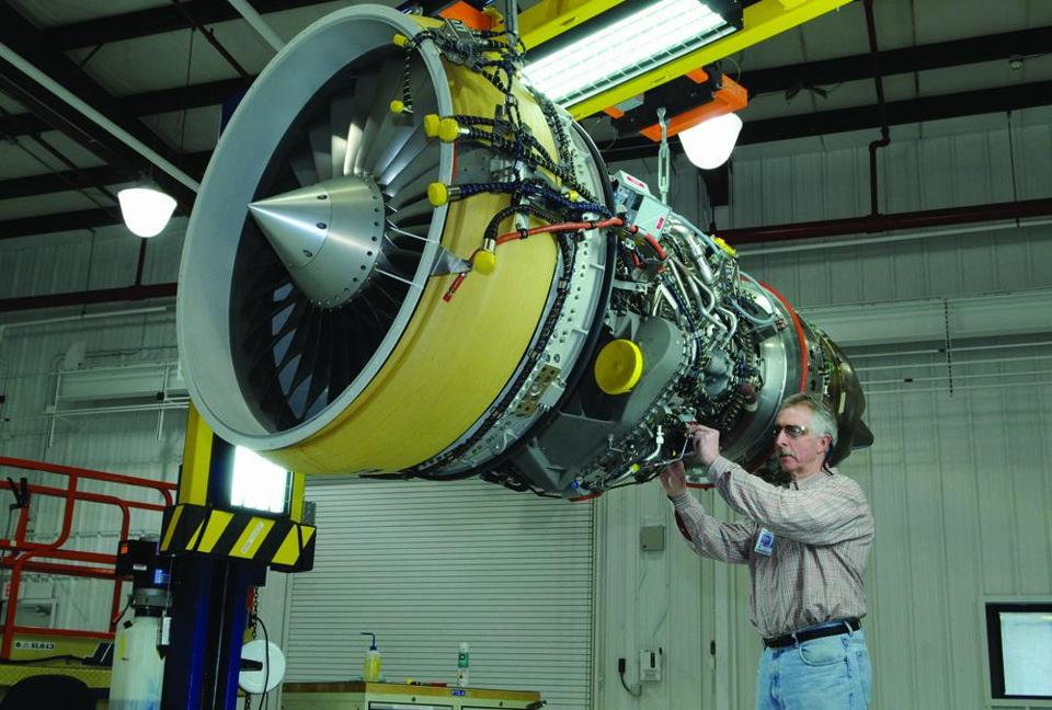 GE employee Mark McDonough inspected a CF34 commercial jet engine at the Lynn General Electic plant.