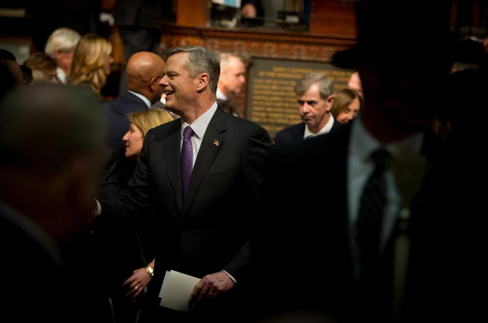 Massachusetts Governor Charlie Baker greeted members of the Legislature as he walked through the chambers of the State House.