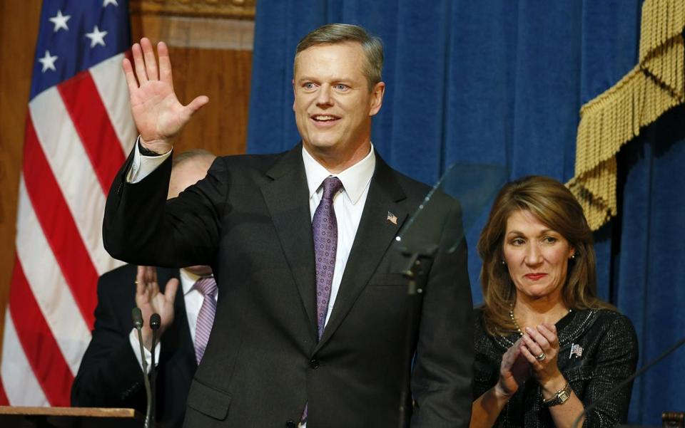 Massachusetts Gov. Charlie Baker waves after delivering his State of the State address as Lt. Gov. Karyn Polito, right, looks on at the Statehouse in Boston, Thursday, Jan. 21, 2016. (AP Photo/Michael Dwyer)