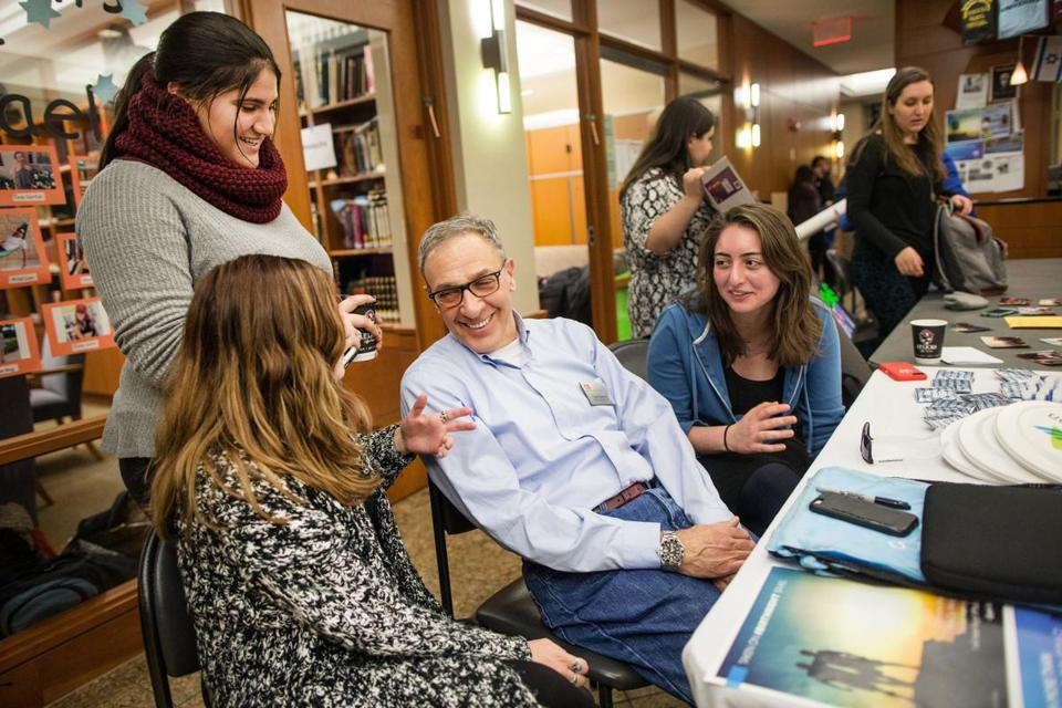 From left, Erin Miller, Carmelle Dagmi, Executive Director David Raphael and Zoe Baruch, converse during an event at BU's Florence & Chafetz Hillel House.