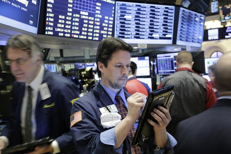 Traders were at work Friday at the New York Stock Exchange.