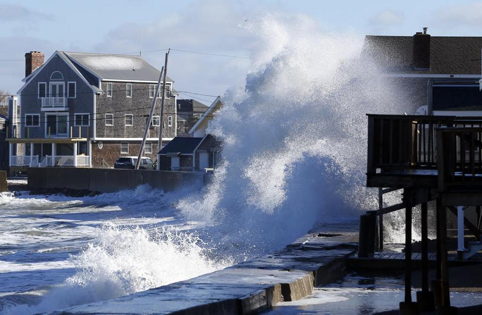 Waves crashed against the sea wall last month on Lighthouse Road in Scituate.