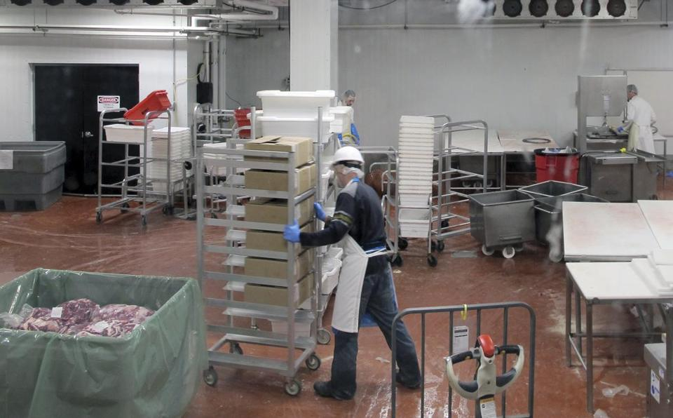 Employees moved carts at Vermont Packinghouse, a slaughterhouse in North Springfield, Vt.