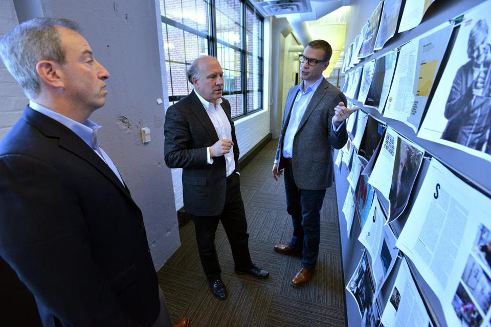 Harvard Business Review Group publisher Josh Macht, editor-in-chief Adi Ignatius, and creative director James deVries looked over mock-ups.