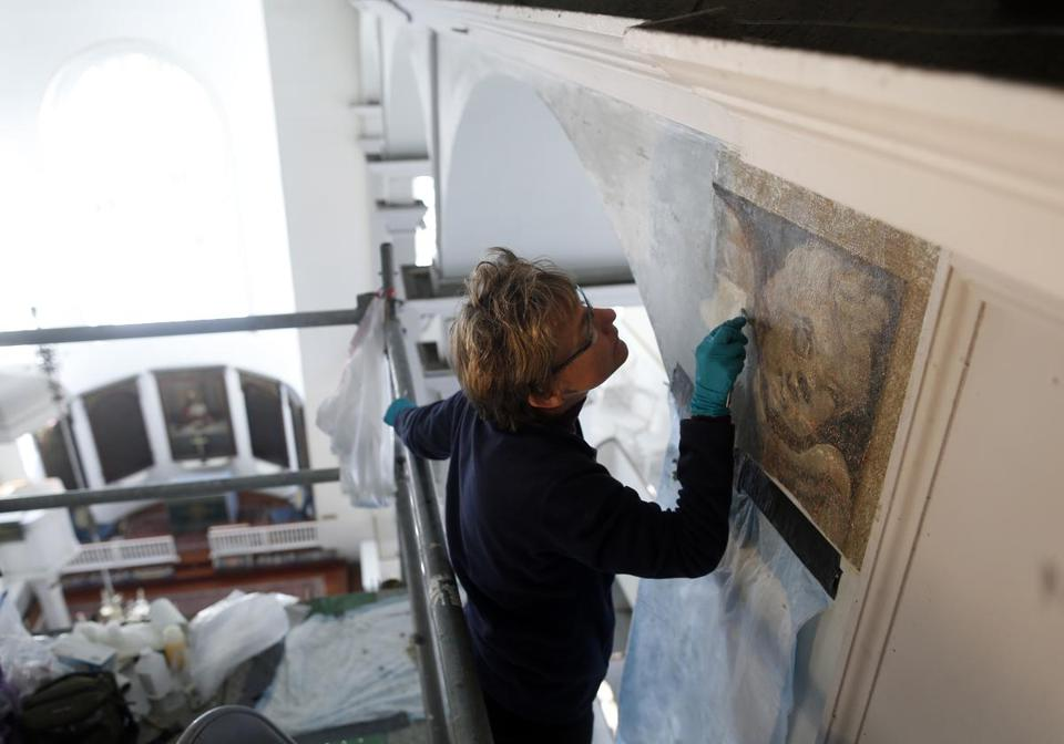 Architectural conservator Melissa McGrew removed layers of paint to uncover a hidden cherub inside Old North Church in Boston.