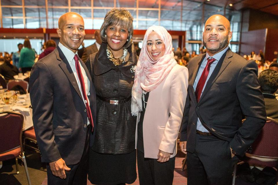 01/18/2016 BOSTON, MA L-R Rob Miller Marcum (cq) of Needham, Maureen Alphonse-Charles (cq) of Milton, Suzan El-Rayess (cq) of Winchester, and Kenneth Willis (cq) of Stoughton, attend the 46th annual MLK Memorial Breakfast held at the Boston Convention and Exhibition Center. (Aram Boghosian)