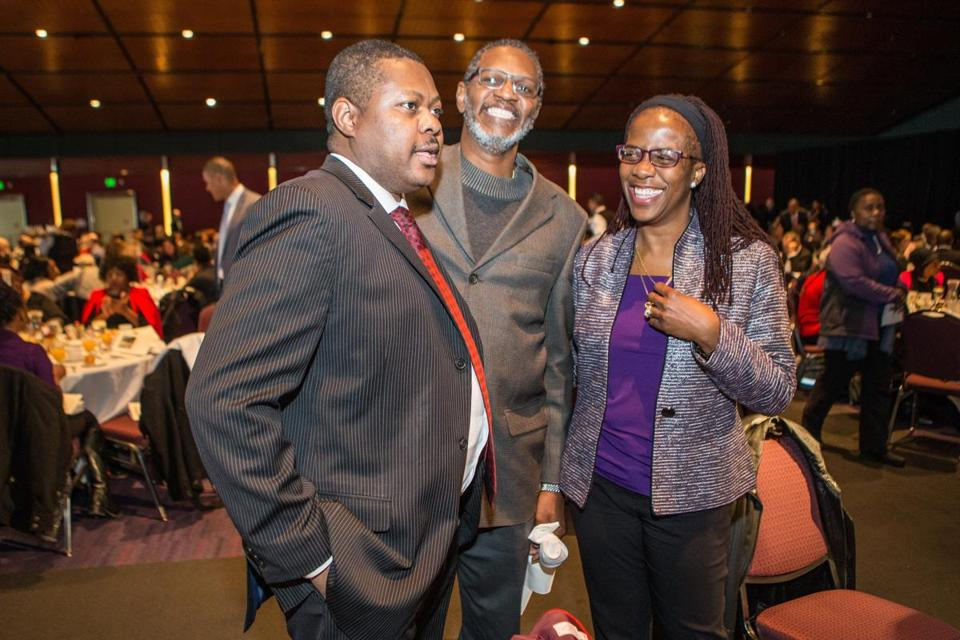 01/18/2016 BOSTON, MA L-R Antoine Melay (cq), Maxie Fahie (cq) and Carla Fahie (cq) conversed during the 46th annual MLK Memorial Breakfast held at the Boston Convention and Exhibition Center. (Aram Boghosian)