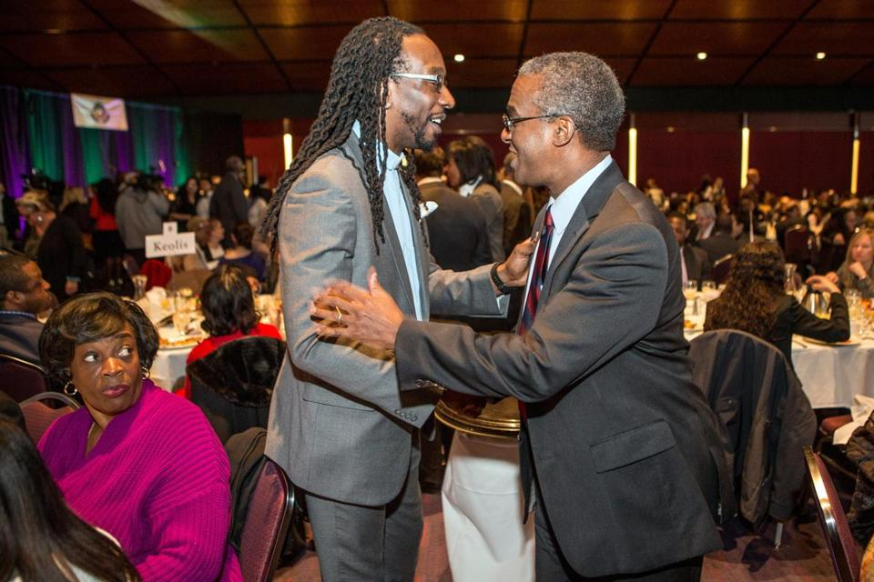 01/18/2016 BOSTON, MA Reverend Jay Williams (cq) (left) and Paul Alexander (cq) greeted each other during the 46th annual MLK Memorial Breakfast held at the Boston Convention and Exhibition Center. (Aram Boghosian)