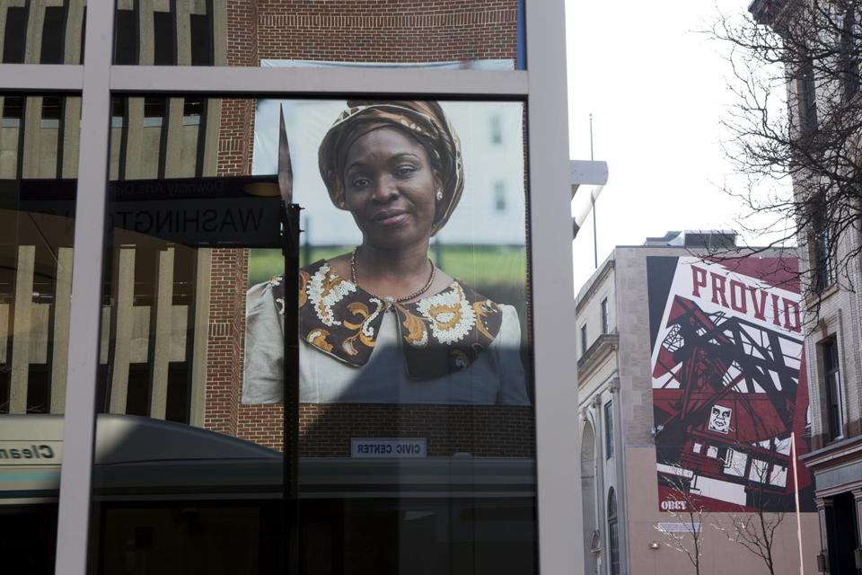 "A portrait of Omowunmi Martins is part of Mary Beth Meehan's installation ""SeenUnseen"" in Providence."