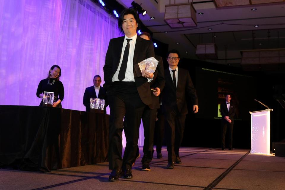 "Boston, MA -- 01/28/16 -- Yugon Kim, representing ""Renzo Piano, in collaboration with Stantec"", walks off-stage after receiving the Harleston Parker Award at the Boston Society of Architects Design Awards Gala, held at the Intercontinental Boston on January 28, 2016. Not for other use until Magazine first published on 02/14/16. (Kayana Szymczak for the Boston Globe)"