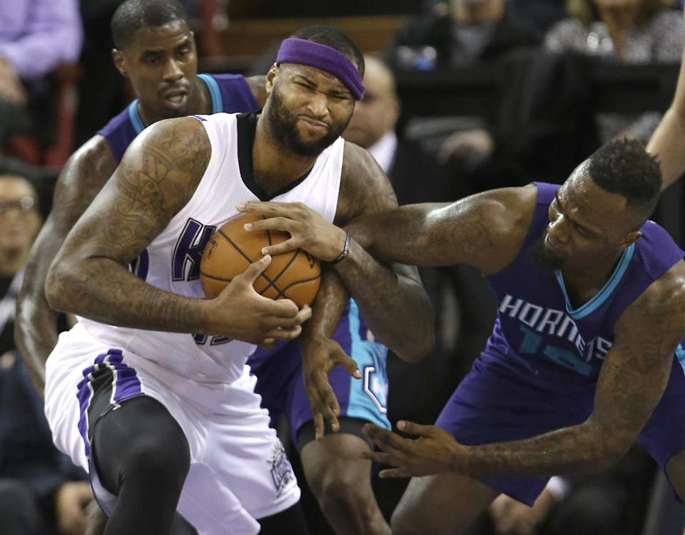DeMarcus Cousins (left) pulled the ball away from P.J. Hairston in the first quarter on Monday.