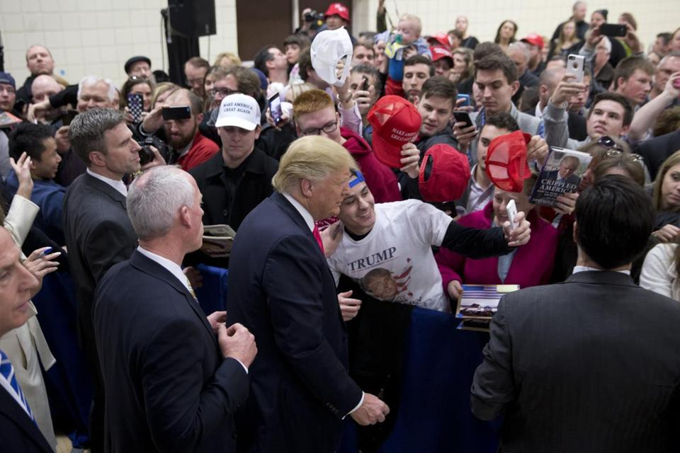 Donald Trump paused for a selfie during a rally in Council Bluffs on Sunday.